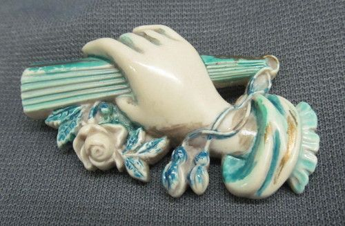 Plastic Hand Holding Folded Fan with Roses Pin