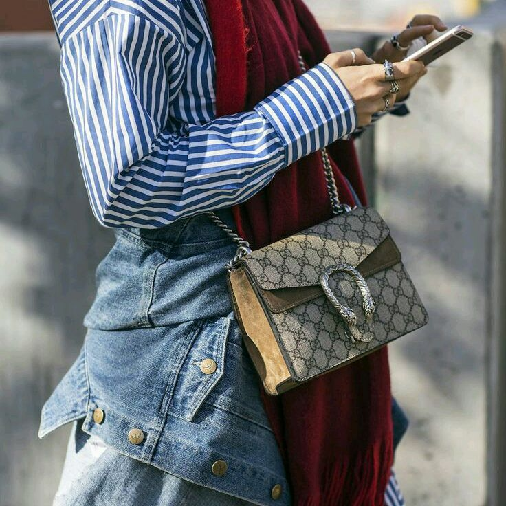 ea622fcdfcde Trending bag at fashion weeks street style: Gucci Dionysus GG supreme  shoulder bags.