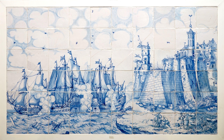 A large Dutch Delft tile panel with a sea coast battle, 17th C ...