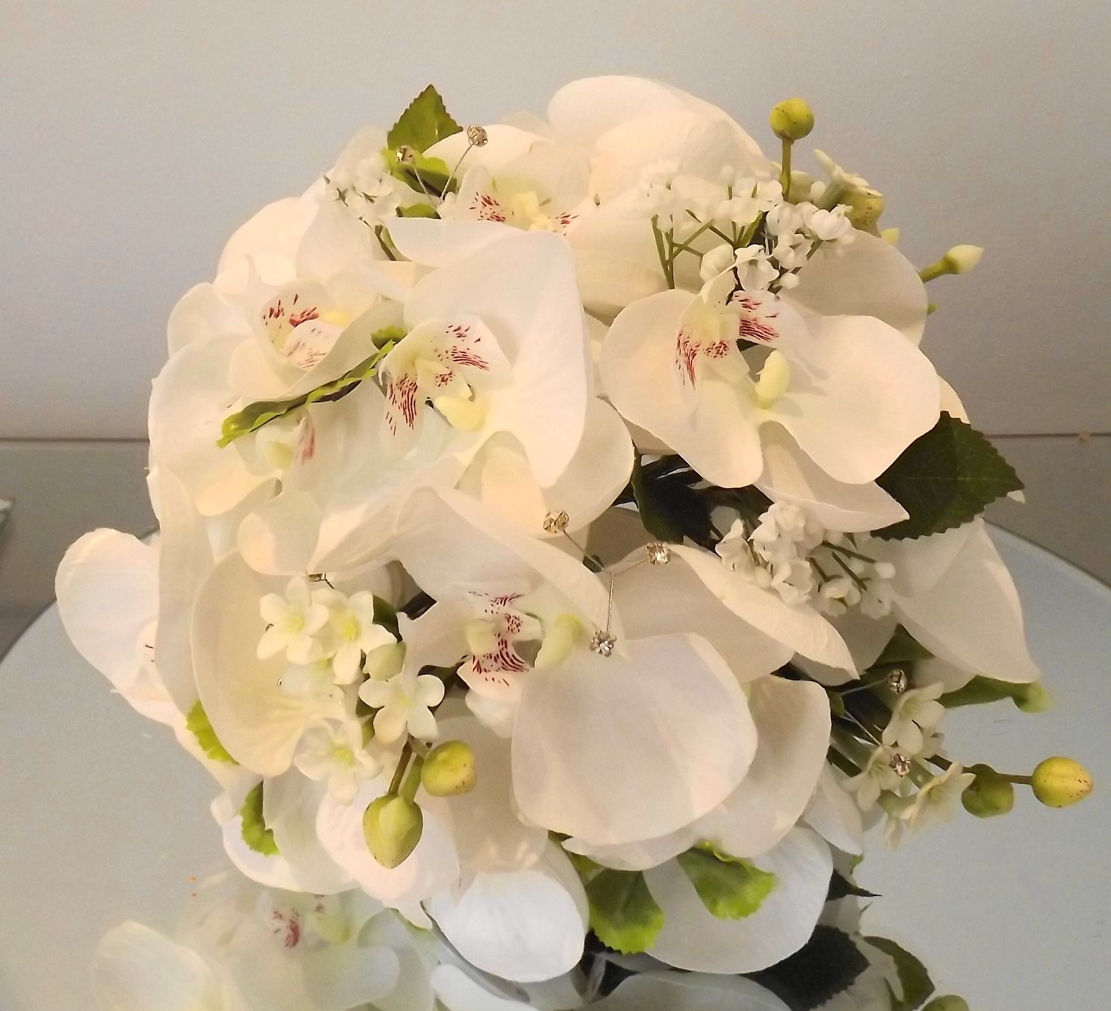 Brides bouquet with orchids... by Emma Hall Designs