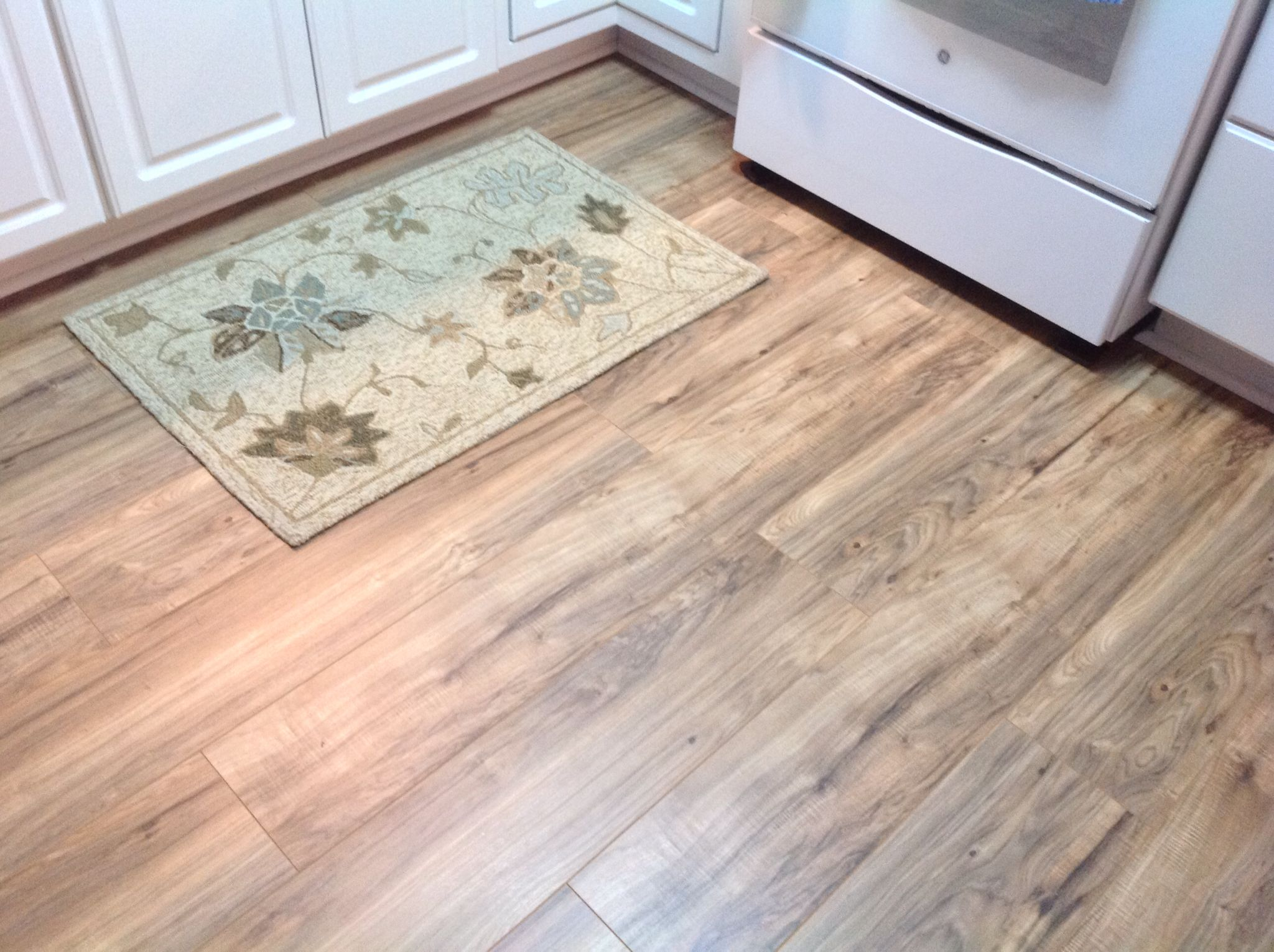 The Finished Kitchen Area Using Trafficmaster Lakes Pecan Laminate You Should Have 2 People Minimum To Install Best Method Is Work From Left