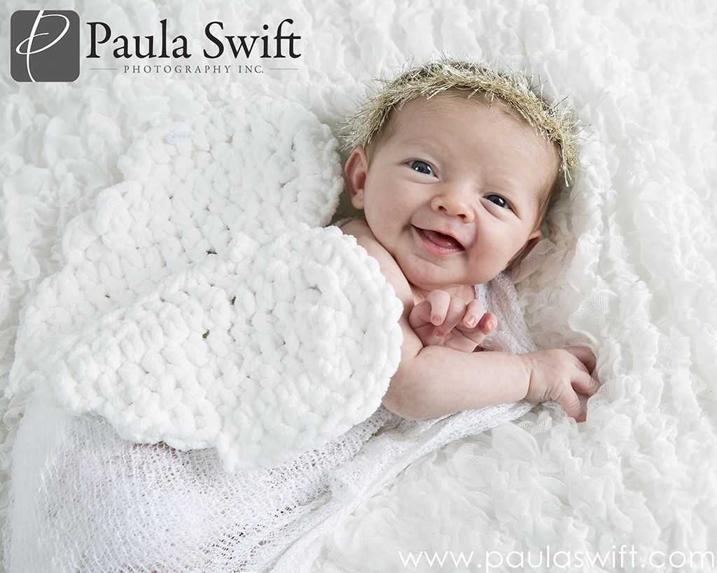 Smiling 2 week old during her newborn session at Paula Swift Photography in  Sudbury, MA . #newbornphotography #bostonphotographer