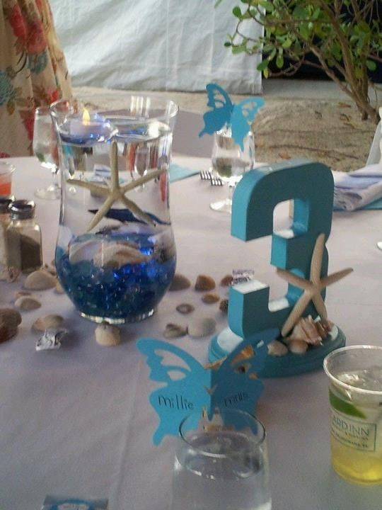 Centerpiece has blue submergible lights floating tea for Beta fish centerpiece