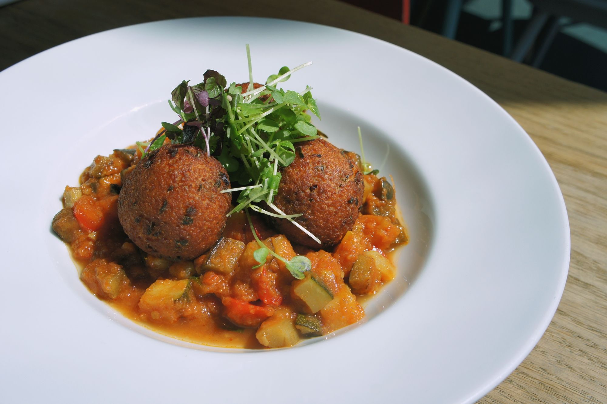 Fried goat's cheese balls / warm ratatouille  #superconceptspace #goatcheese #ratatouille #comfortfood #lunch #berlinfood