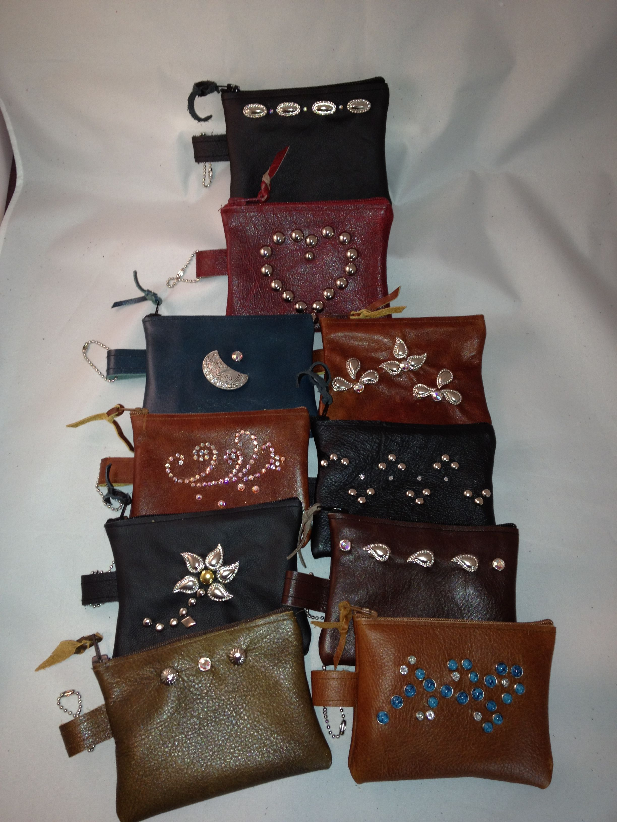 My leather & jewel credit card / cash zippered pouches.