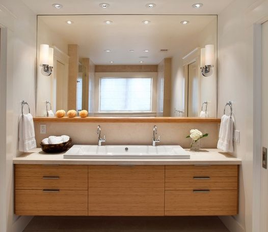 Large Double Sink Bathroom Vanity. A floating wood bathroom vanity with a ceramic sink is below large square  mirror The contemporary also home to small vase filled white double trough Google Search sandalwood bath