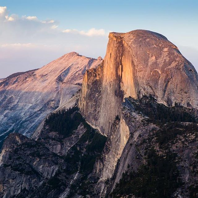 Half Dome just showing off a bit. #WeHaveAnEndlessBucketList⠀  ⠀  Who's been to #Yosemite, and more importantly where should we camp? ⛺️