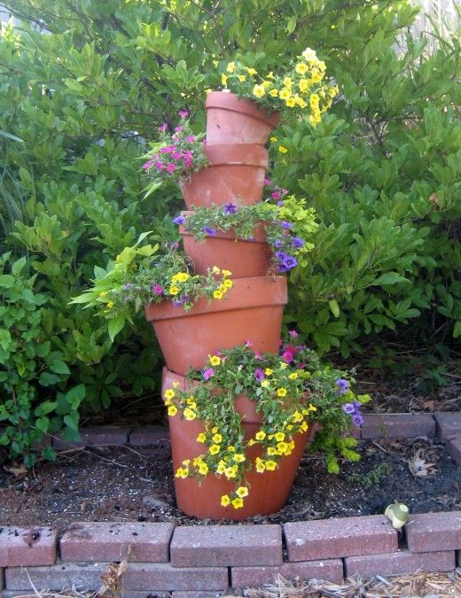 How To Make A Crooked Terra Cotta Pot Flower Tower With Annuals Flower Tower Terracotta Pots Garden Containers