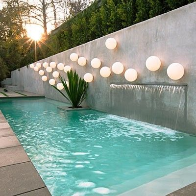 Narrow Pool With Backdrop Wall Water Feature Accent Planter And