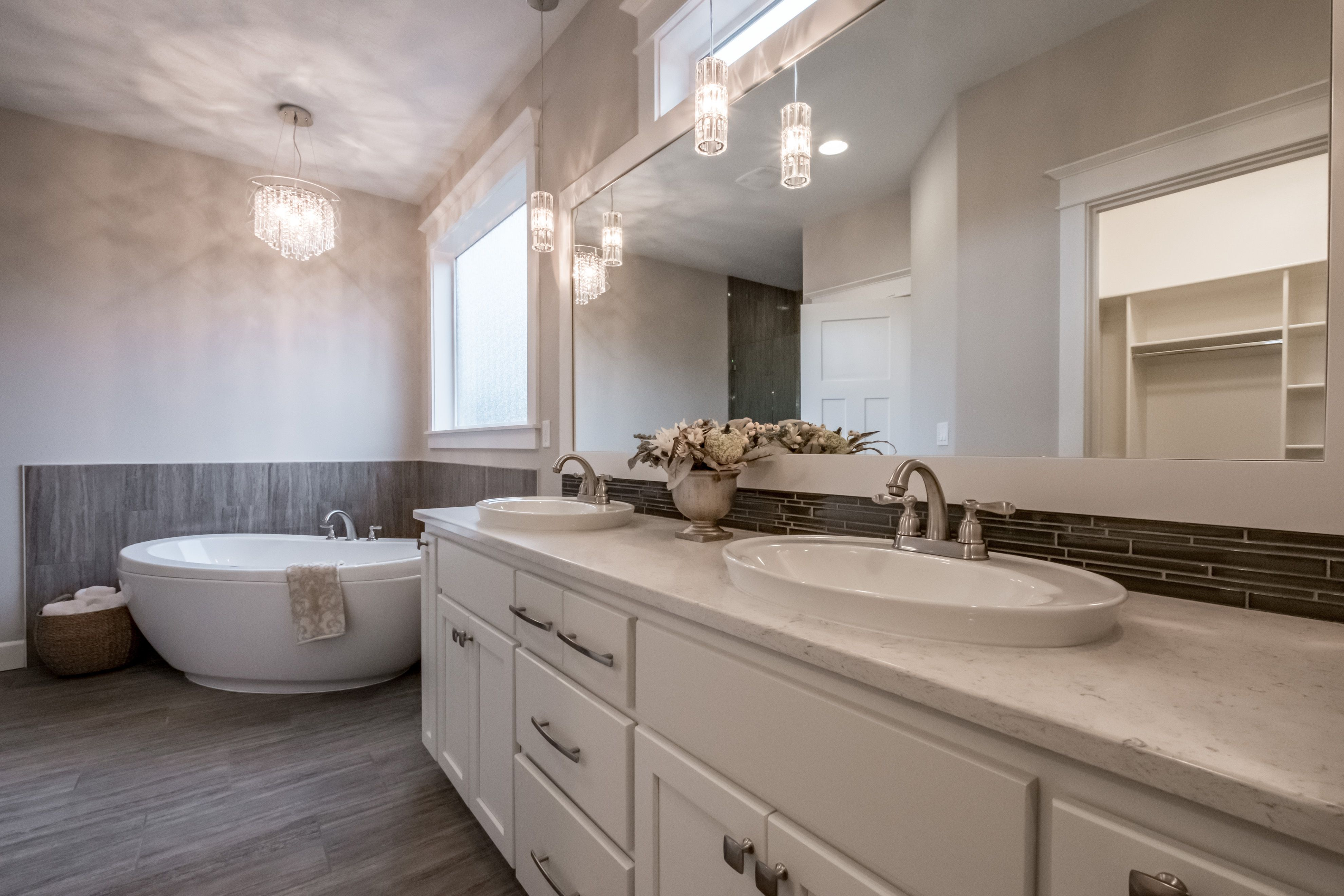 Masterbath with beautiful tile and lighting Wind River Homes