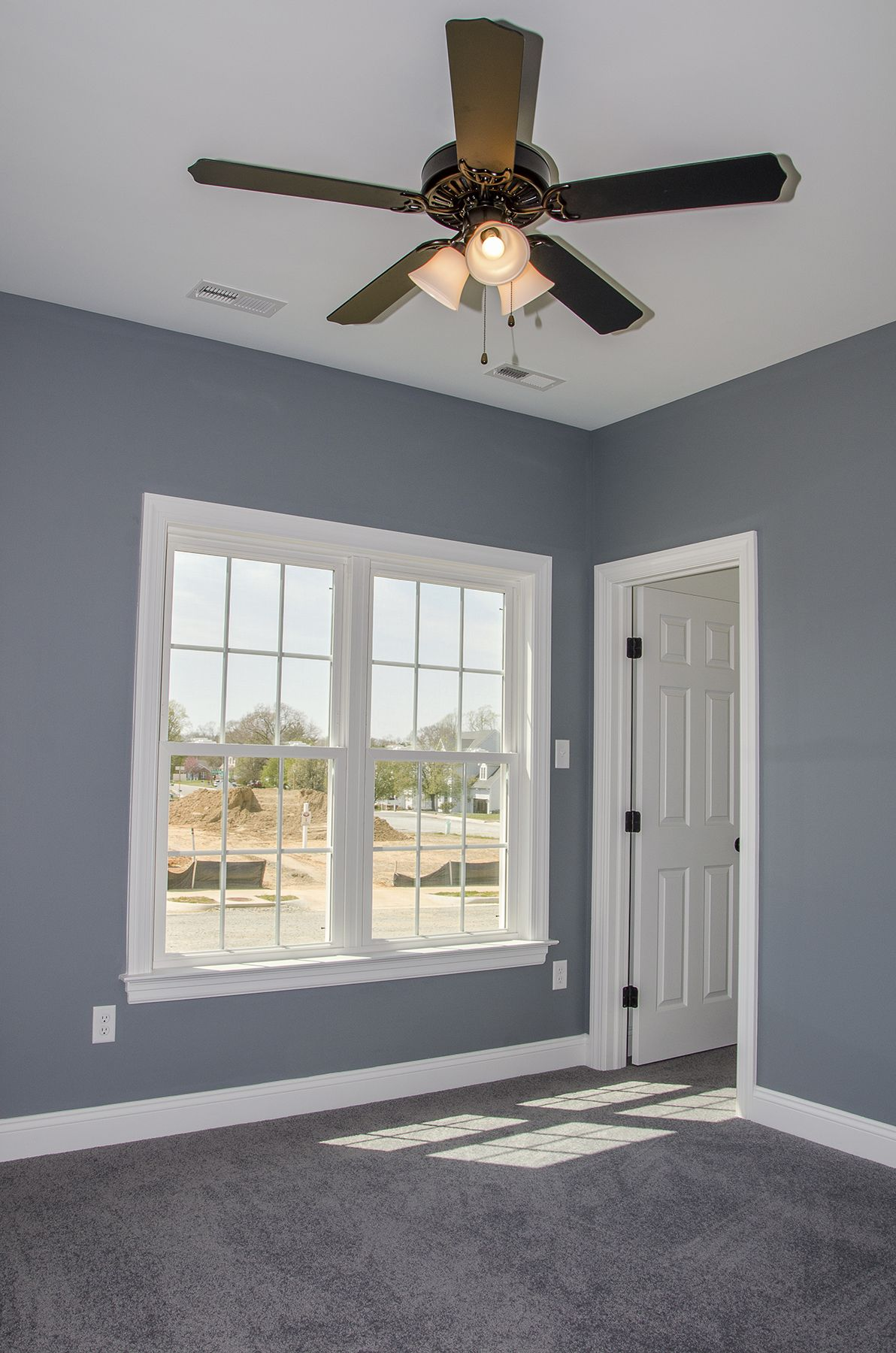 Kids Bedroom Or Guest Bedroom With Gray Blue Walls And Carpet