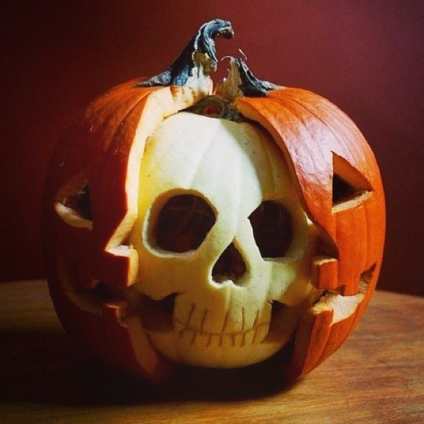 halloween pumpkin carving white pumpkin skull inside orange pumpkin jack o lantern