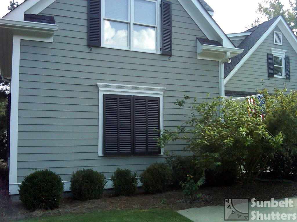 Use Bahamas Shutters To Create A Faux Window On A Remodeled Garage Enclosure These Bahamas Have Shutters Exterior Window Shutters Exterior Louvered Shutters