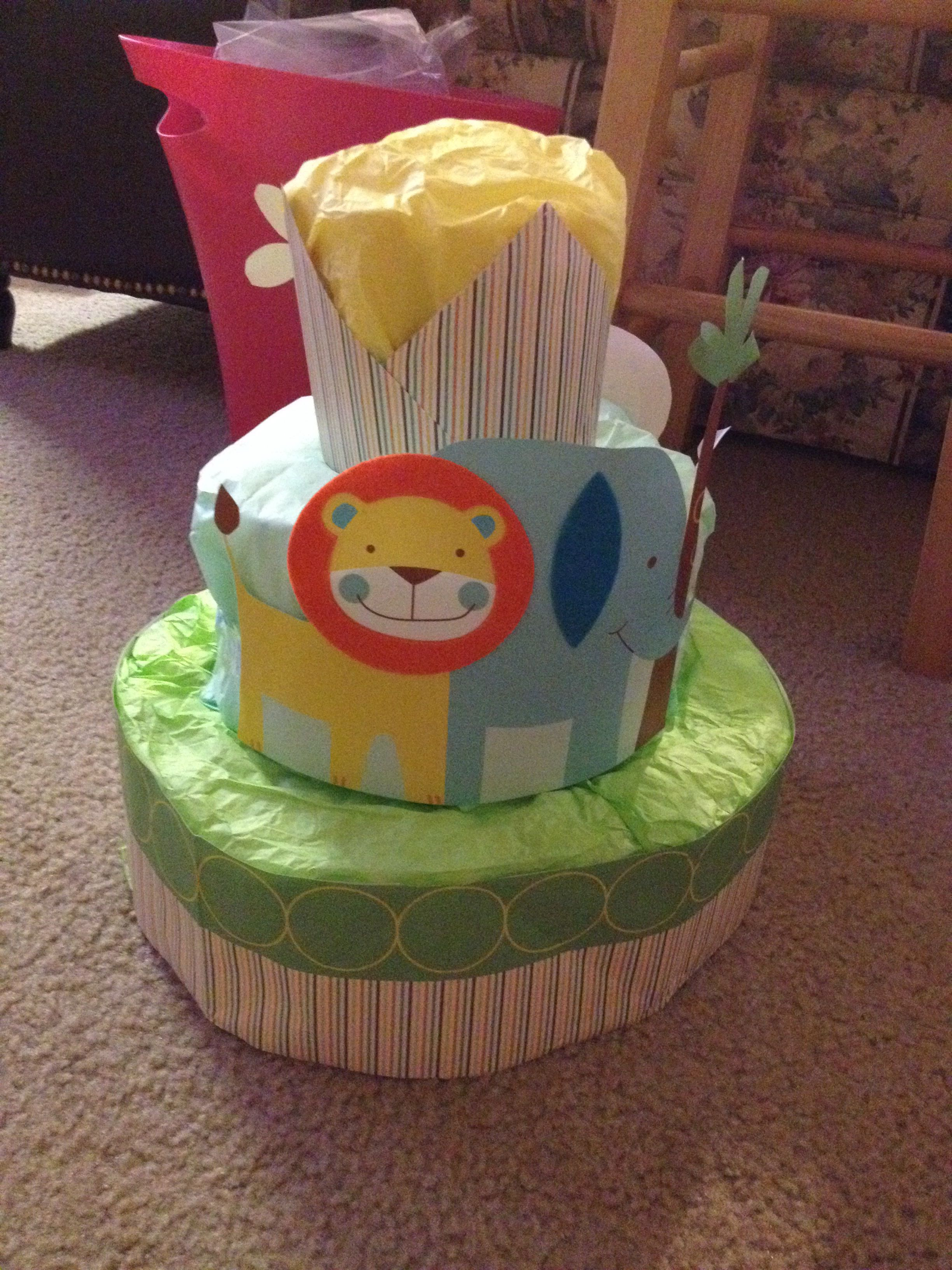 Diaper cake from a gift bag and tissue paper with images