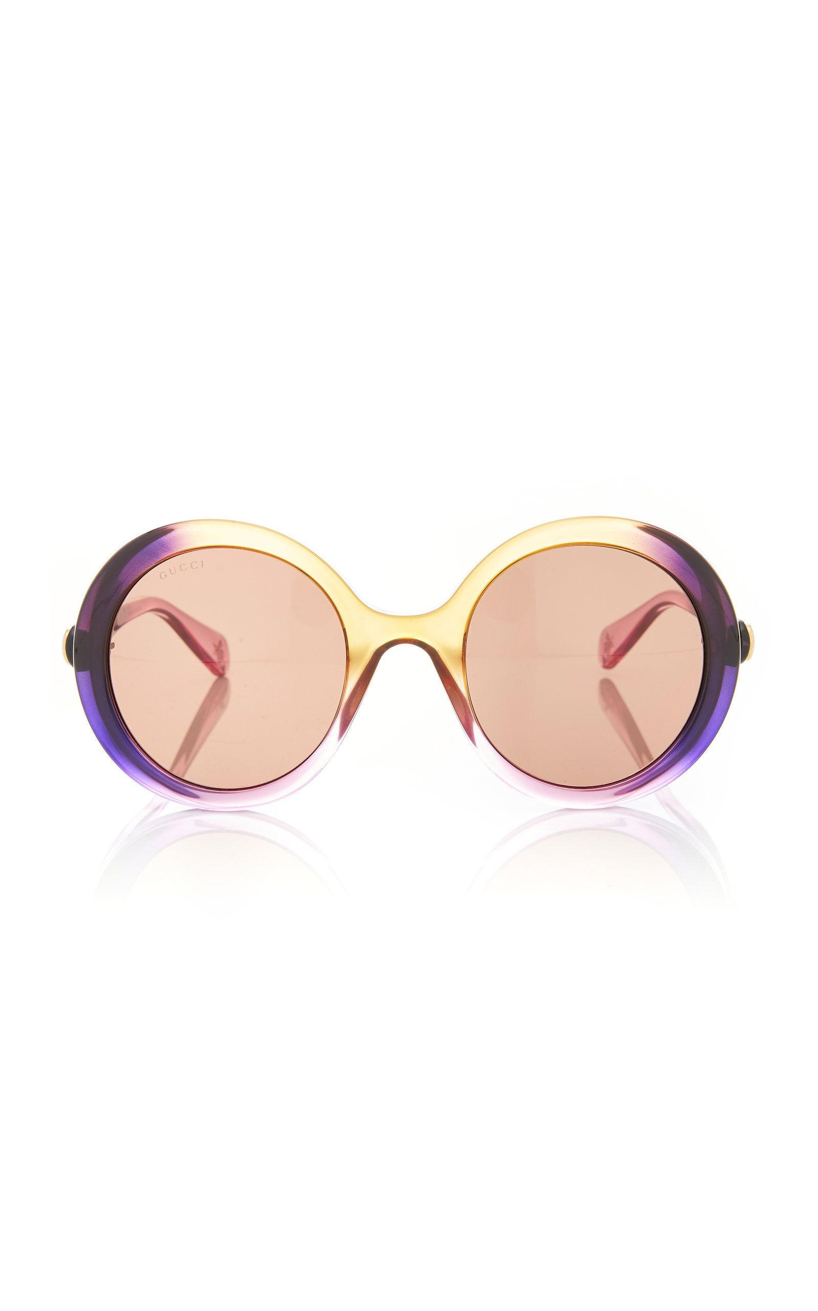 2cc22c82d06df Gucci s  Glamorous  sunglasses are designed from transparent multicolored  acetate with a retro-style oversized silhouette. Dark lenses add to their  allure ...