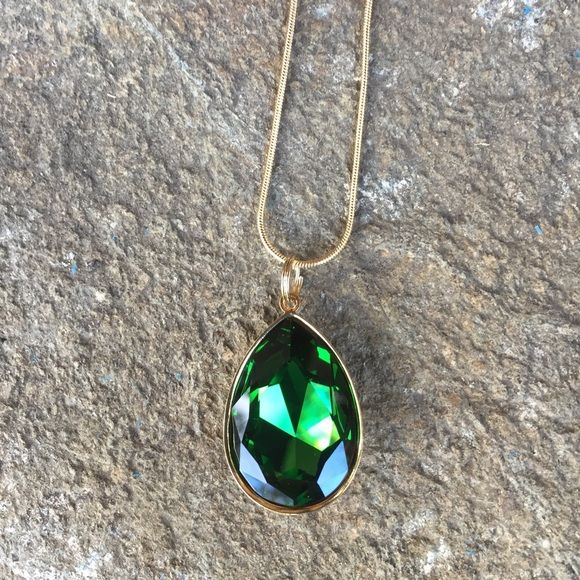 Emerald green Swarovski necklace Emerald green Swarovski teardrop necklace with a gold tone setting and chain.  The 2nd picture illustrates approximate size.  My husband and I make jewelry using genuine Swarovski crystals. All items are new and much prettier in person than pictures. Proceeds used to help our 5-yr-old granddaughter Lila May in her fight against cancer, but she lost her battle. Now she is dancing with the angels.  A percentage of profit will go to Neuroblastoma charities…