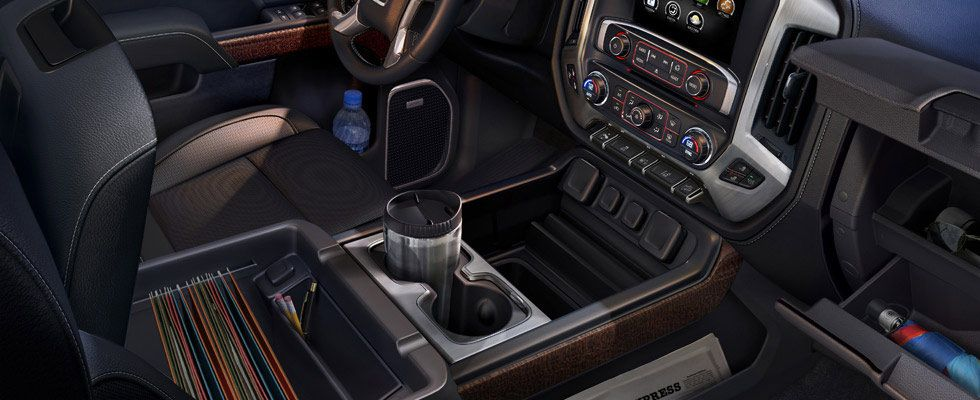 The 2014 Gmc Sierra Has A Center Console That Is Large Enough To