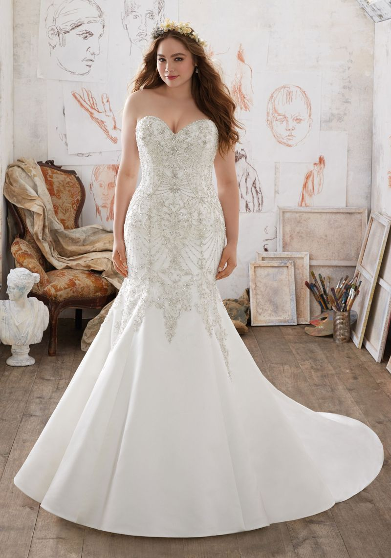 Crystal beaded embroidery adorns the strapless sweetheart