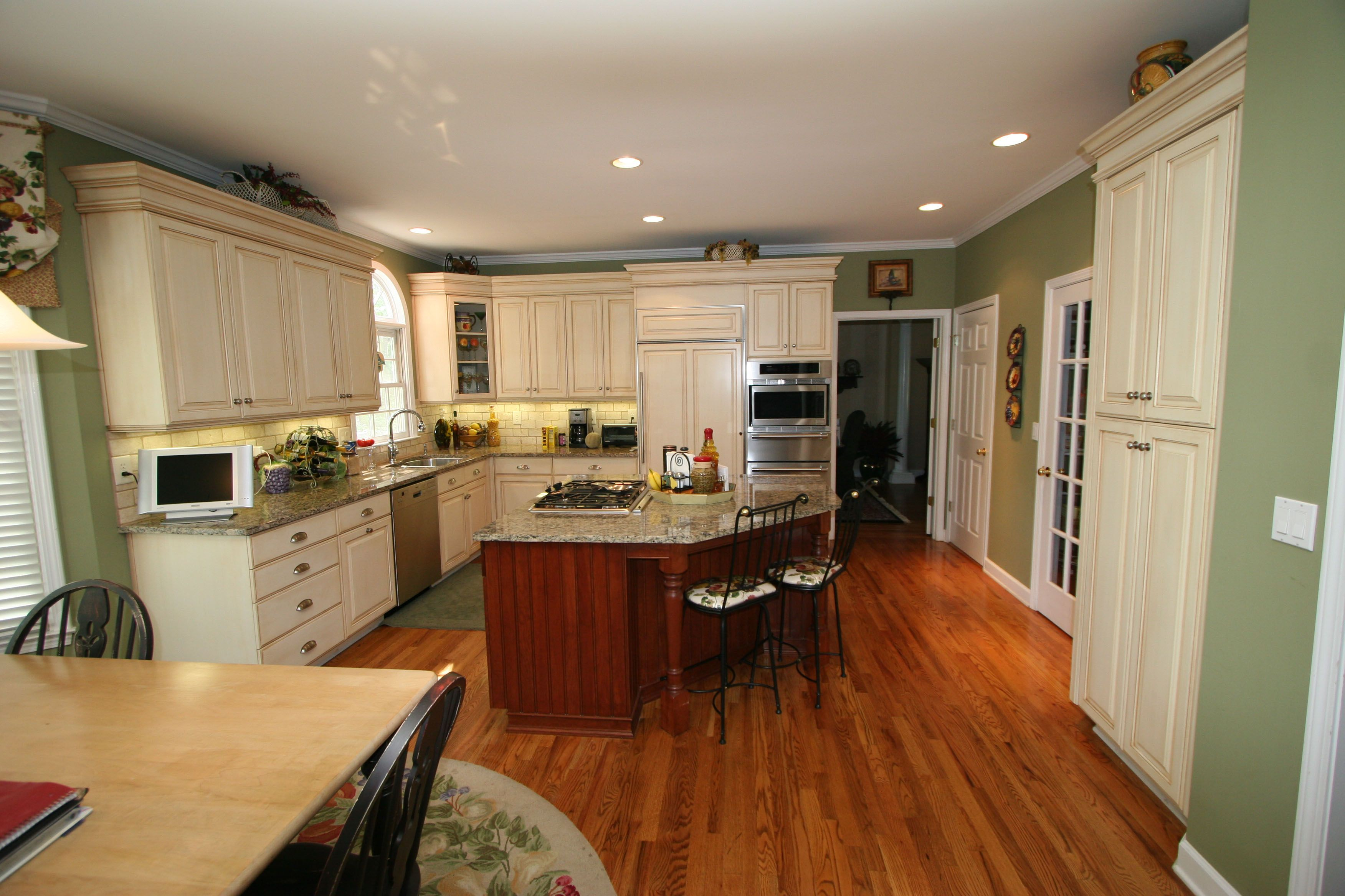 Creative Cabinetry created this beautiful white stained ...
