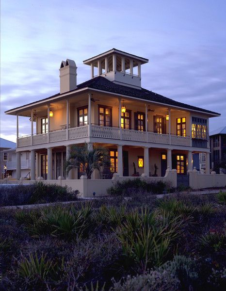 Great beach house with all those porches a tower to see for Beach house designs with wrap around porch