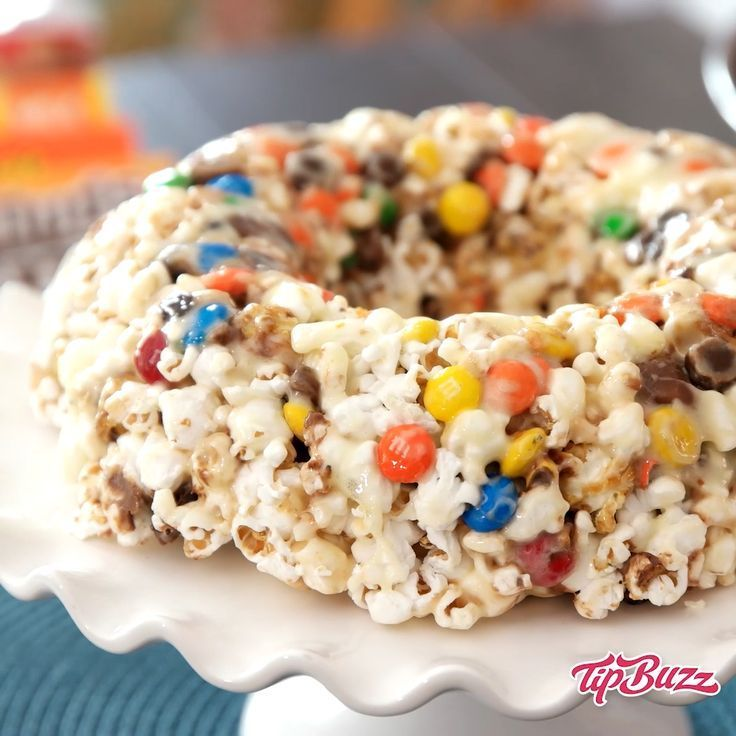 Popcorn Cake is a classic dessert of popcorn, candy, marshmallows molded in bund... -