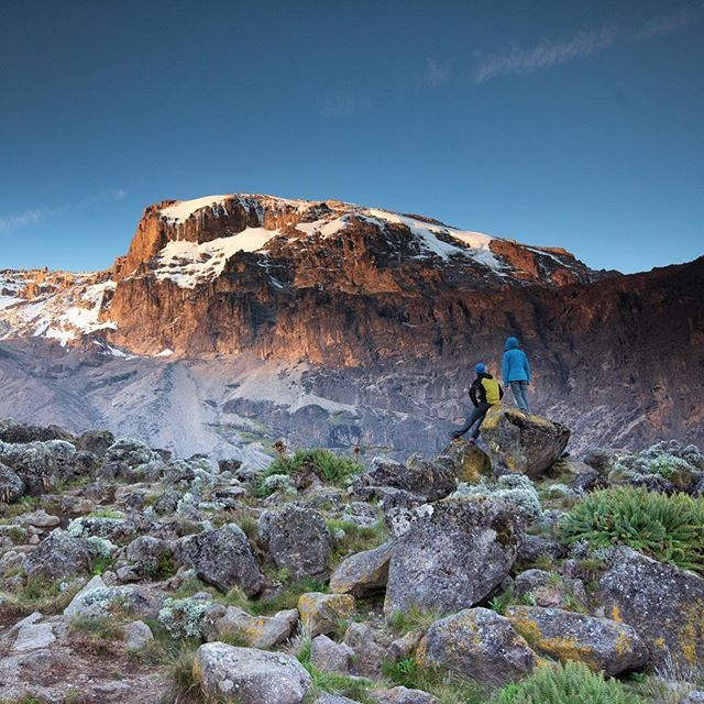Photo @ladzinski / #MtKilimanjaro is Africa's highest mountain towering at 19,341ft tall. The hike to the top passes through 5 distinct ecosystems which you witness in slow and steady progress as you make your way to the summit. The first documented Summit was in 1889. Today the mountain sees some 25,000 summit visitors each year.  @mikelibecki and @lilliana_libecki seen here staring at the summit from our basecamp on day 4 of our approach.
