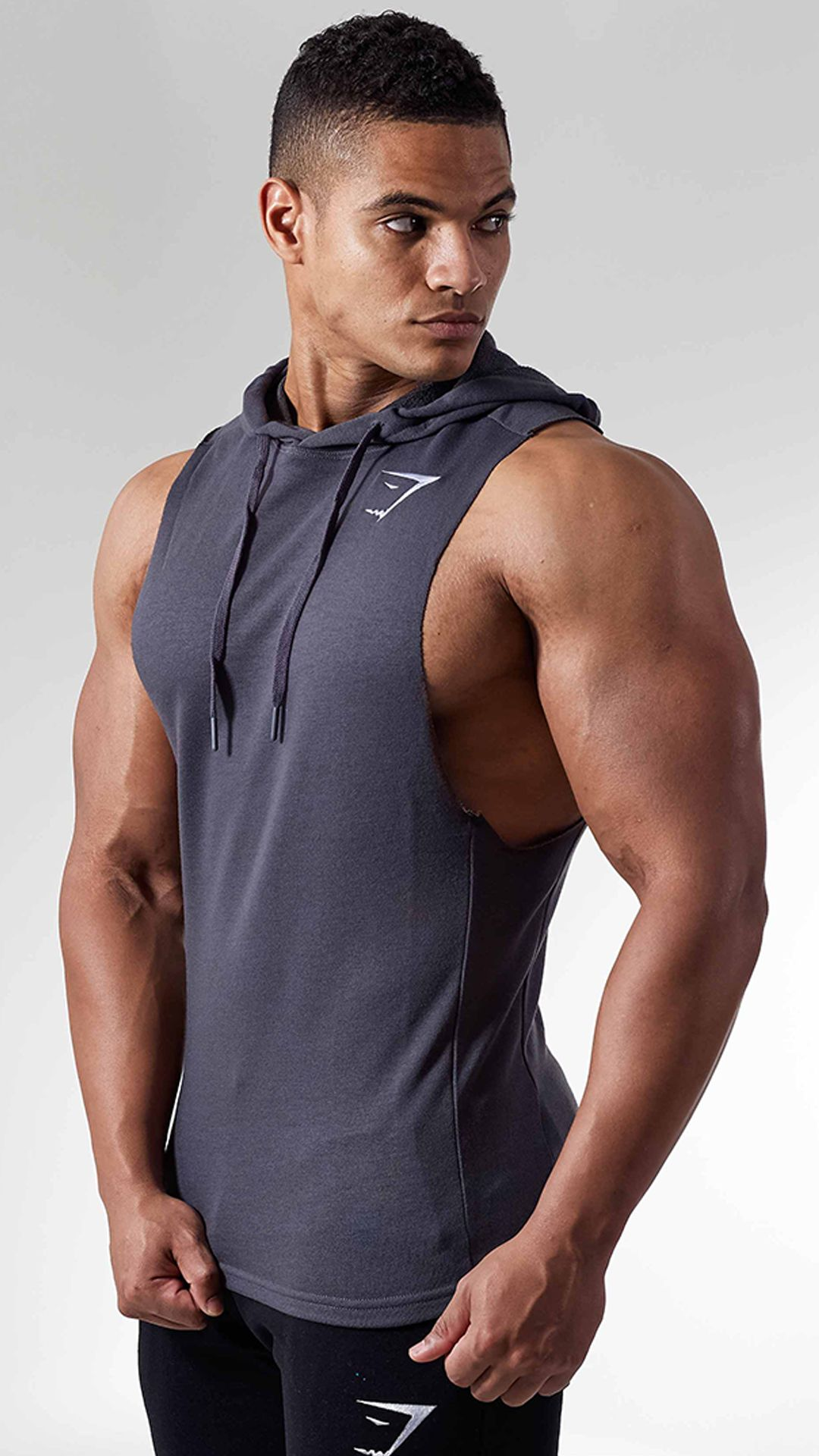 f7d8166cabbe2a The Drop Arm Sleeveless Hoodie is ready for your most intense workout. With  raw edged armholes and incredibly soft blend