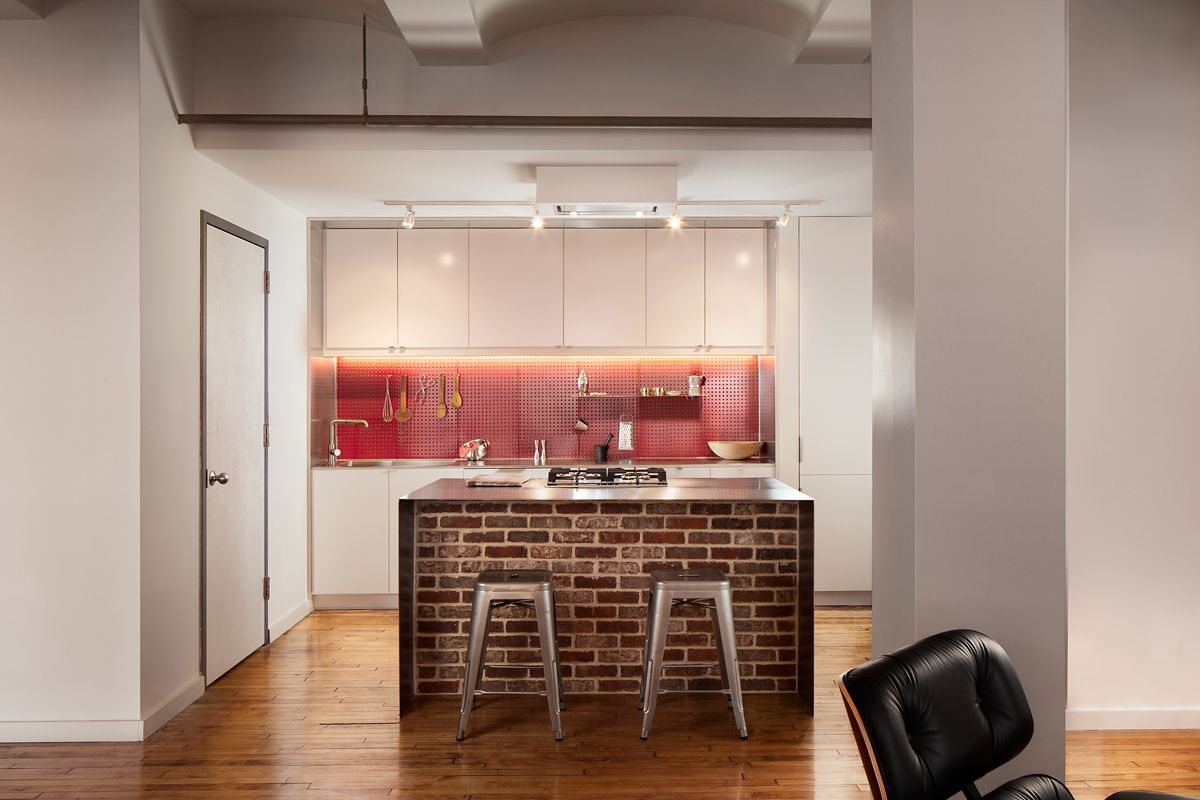 A Boston loft in a former textile factory receives a minimal ...