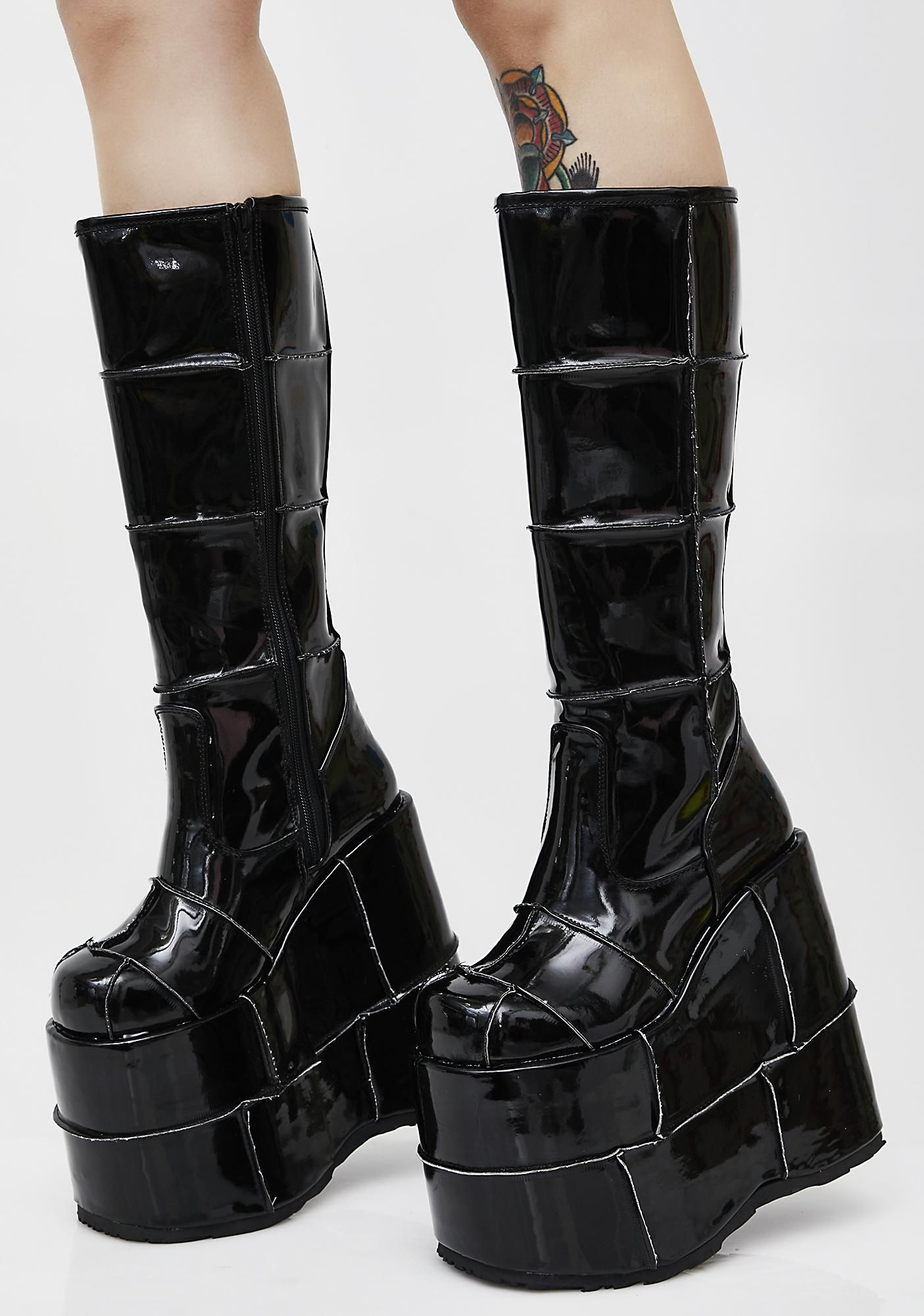 4c9aa65798c9 Demonia Patent Stack Platform Boots will take ya higher than ever. These  black patent boots have super thikk platform soles