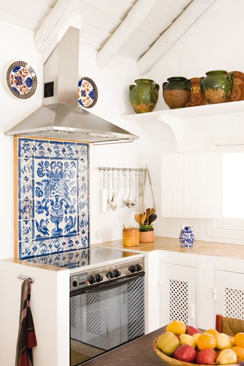 Retreat of French interior designer Jacques Grange.  Beautiful Portuguese ceramic tiles and perforated cabinet doors.