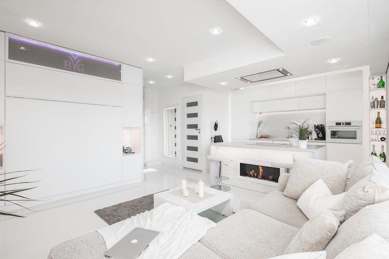 Small Apartment With Unique Interior Design Covered In Glossy White Small Apartments Unique Interior Design White Interior Design