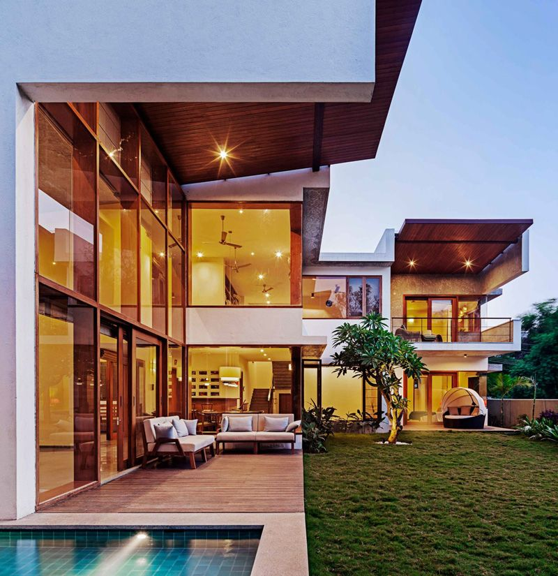 Home Garden Design Ideas India: This L-Shaped Home's Double Height Living Room Opens To