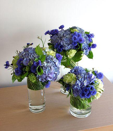 Hydrangea And Cornflower Good Shape But More Blue White Not Green Blue Flower Arrangements Flower Centerpieces Wedding Wedding Table Flowers