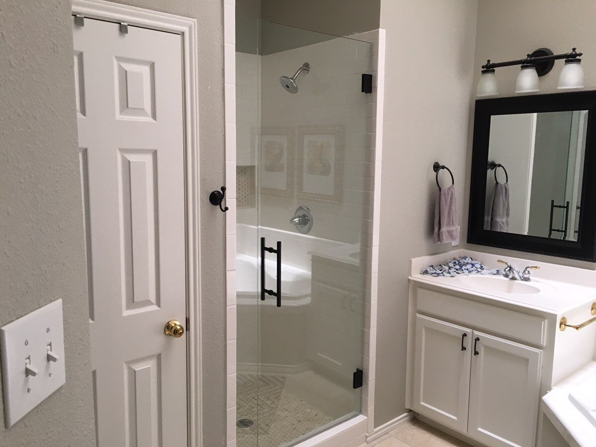 Frameless Inline Shower With Stationary Panel And Door That Swings In And Out 8 Ladder Pull Han Frameless Shower Enclosures Frameless Shower Shower Enclosure