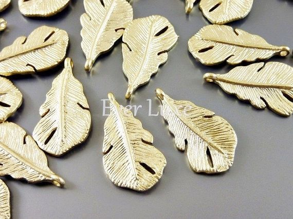 Hey, I found this really awesome Etsy listing at https://www.etsy.com/listing/164161357/4-small-birds-feather-charms-matte-gold