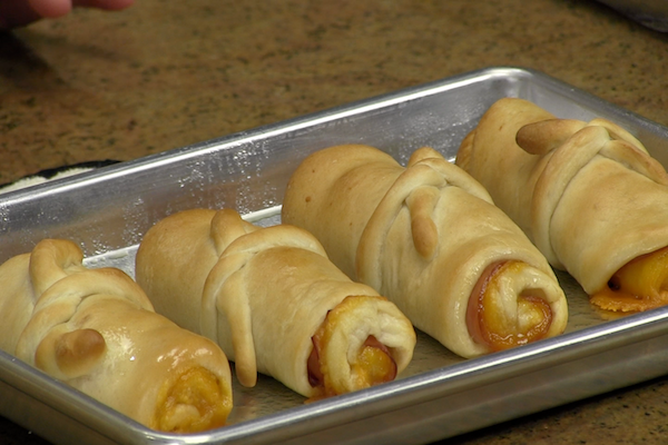 Diploma rolls-- Rhodes rolls stuffed with ham & cheese. Cute idea for kid's party food.