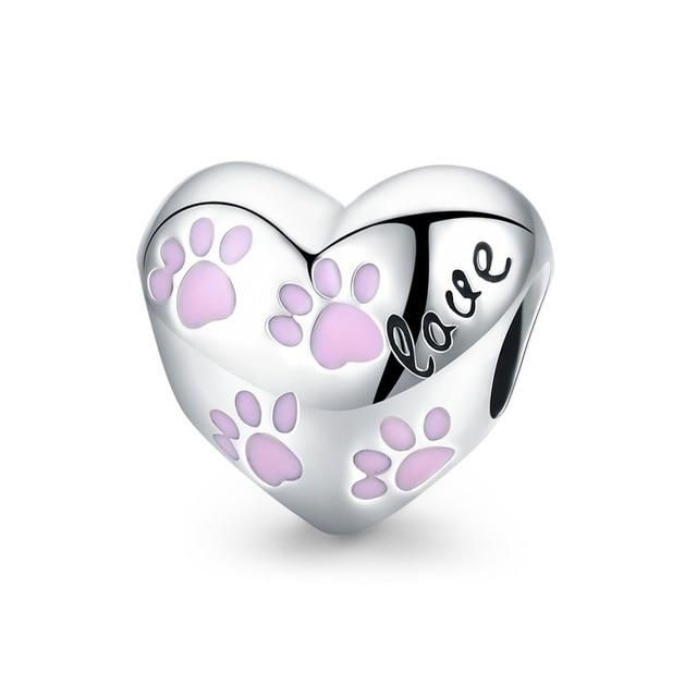 """Bring the joy of a loyal friend everywhere with this Sterling Silver Love Heart Puppy Charms Pendant. It feature a puppy holding a big pink heart with the Love print. This stylish pendant goes perfect with the Sterling Silver Cat Face-Shaped Pendant Bracelet or with your silver necklace. Material: 925 Silver Sterling Features a puppy holding a big pink heart with the Love print. Cubic Zirconia Size: 2.3x0.9cm(0.9""""x0.4"""") Note: Due to very high demand, please allow 3 - 4 weeks for delivery"""