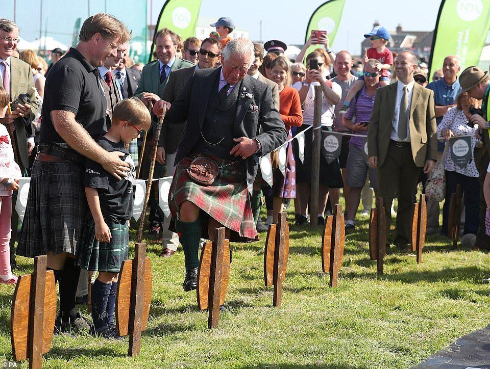 Prince Charlie dons kilt to judge tug of war final at