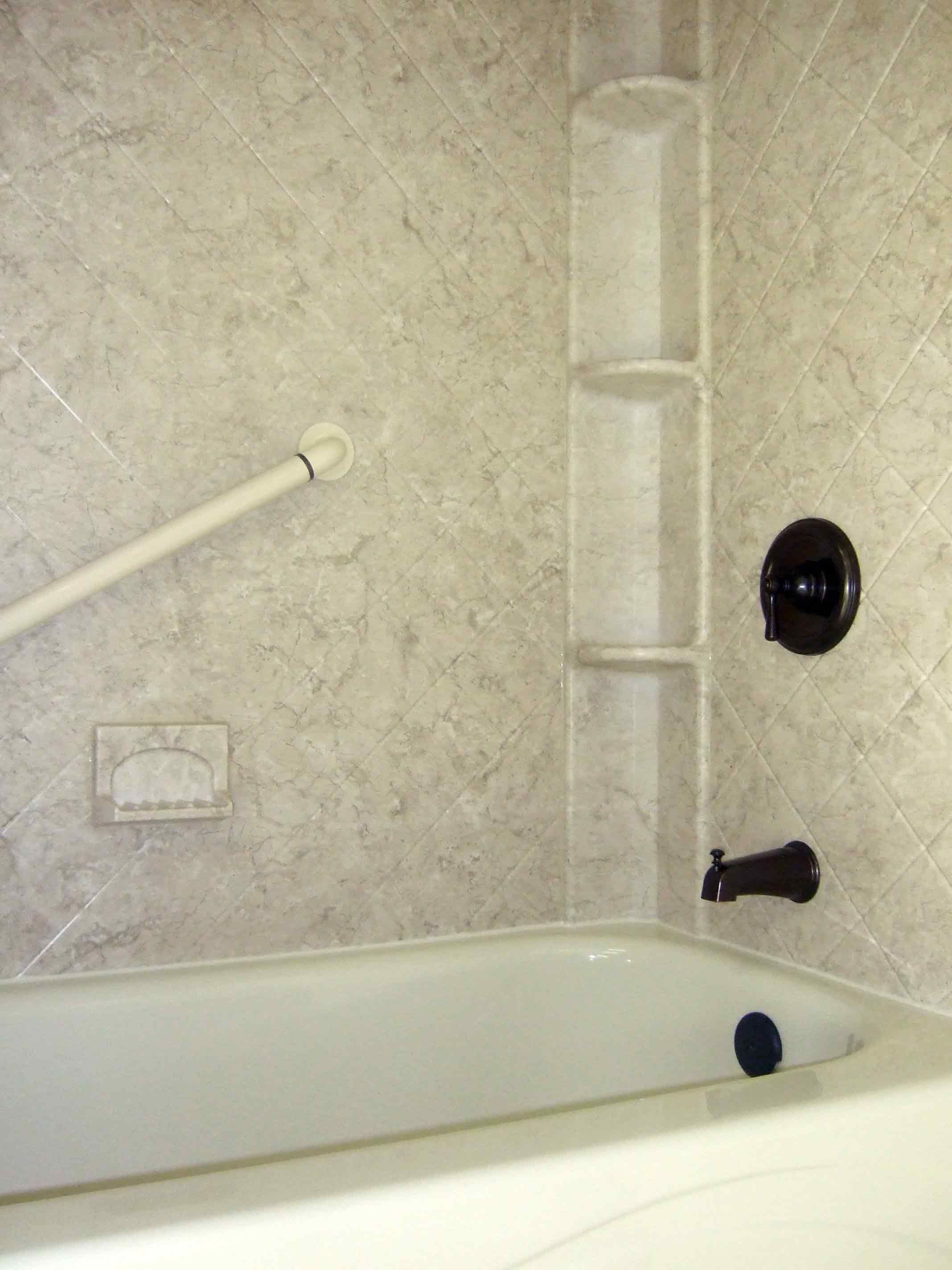 Acrylic shower walls with Breccia pattern and shower caddy | Shower ...
