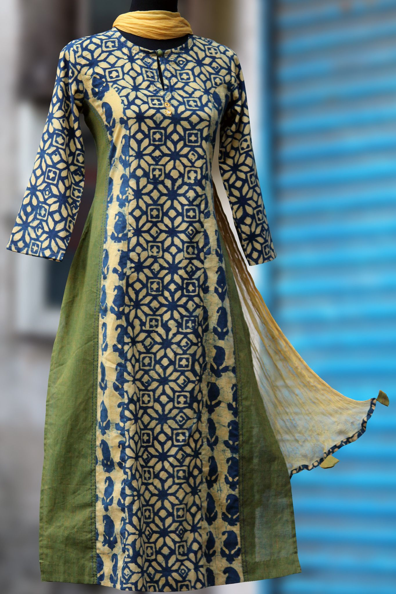 A long kurta with indigo mustard print with mangalgiri in side kalis