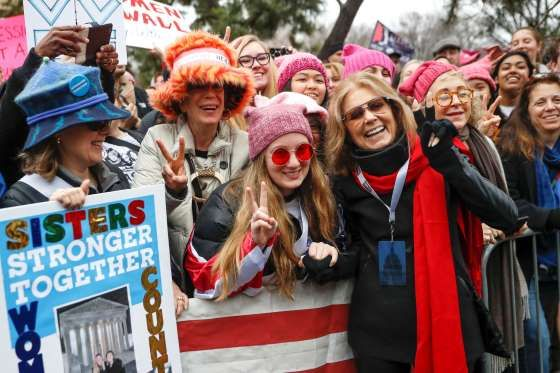 Gloria Steinem, center right, greets protesters at the barricades before speaking at the Women's Mar... - John Minchillo/AP Photo