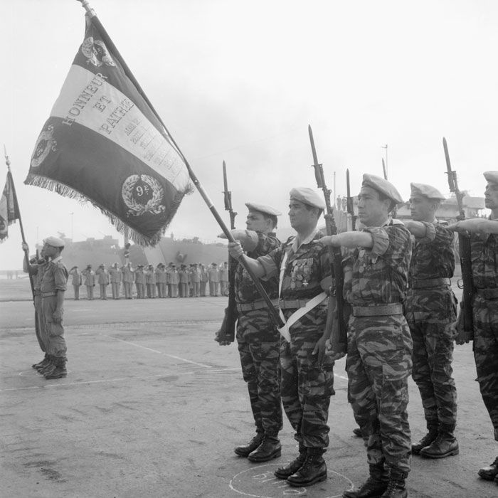 The final parade  of the final French troops in Algiers on their departure. This general review was of the 1st Regiment Spahis and 9th Infantry Marine Battalion. Photo shows the colour party of 9th Infantry Marine