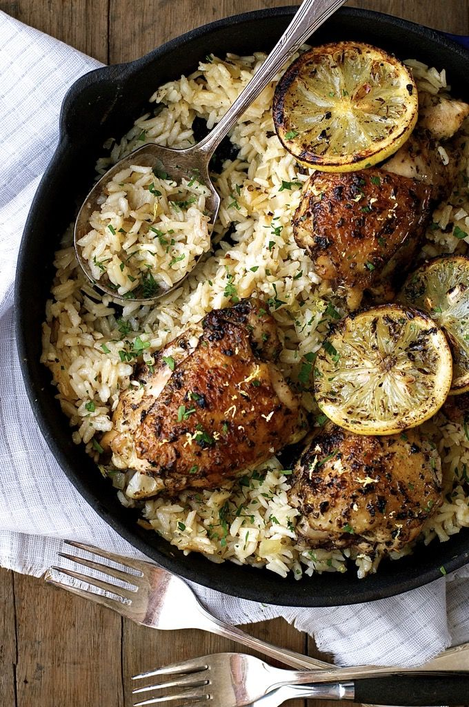 An incredible Greek Chicken recipe with lemon rice - all made in one pot. Even the rice is cooked right in the same pan as the chicken!