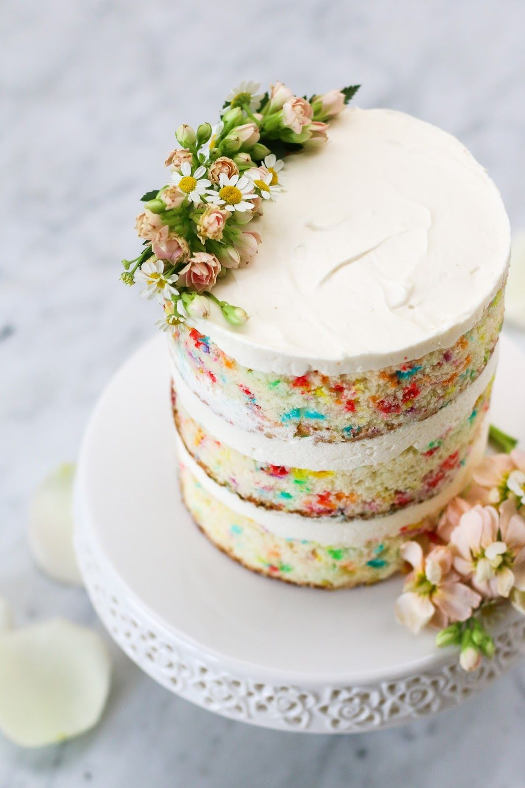 Funfetti cake with whipped cream cheese frosting with