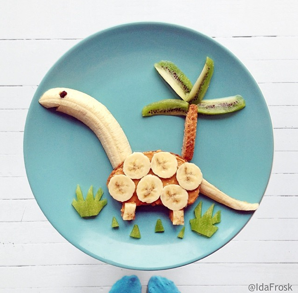 The  Instagram page of Idafrosk  is chock-full of super creative meals for kids, but this peanut butter and banana toast was too cute not to share. Love the kiwi grass! #dinosaurart