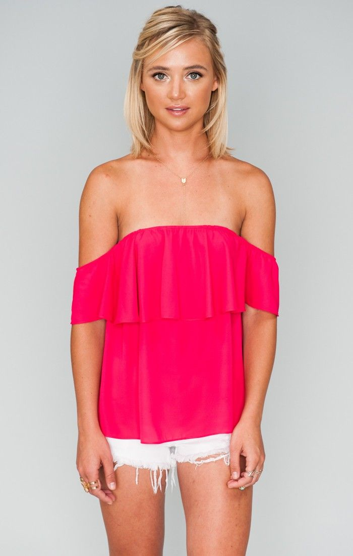 Chiquita has fluttered into spring and is here to stay. A light and flowy layer dances off the shoulder on an A-line fit that makes it an easy pairing with those jean shorts.  Go all the way in flares for that boho 70's chic and don't forget to jewel up!   *MADE IN THE GORGE USA* *100% Poly *Elastic around the bust and sleeves *Ruffle creates lining  *Basically Wrinkle-proof.  Throw in purse for later recommended