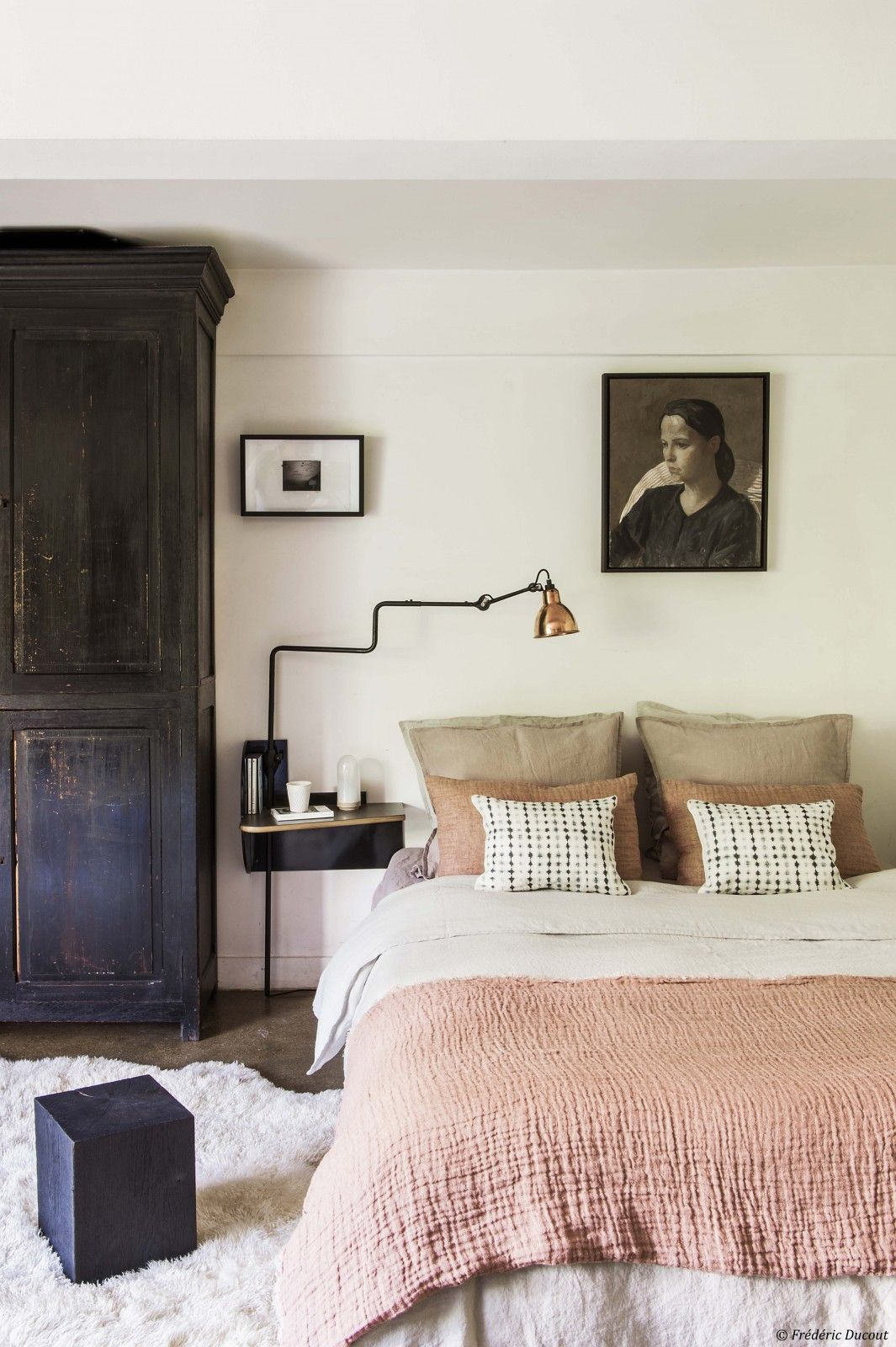 Tones of blush and creams combine with dark wood for a soothing