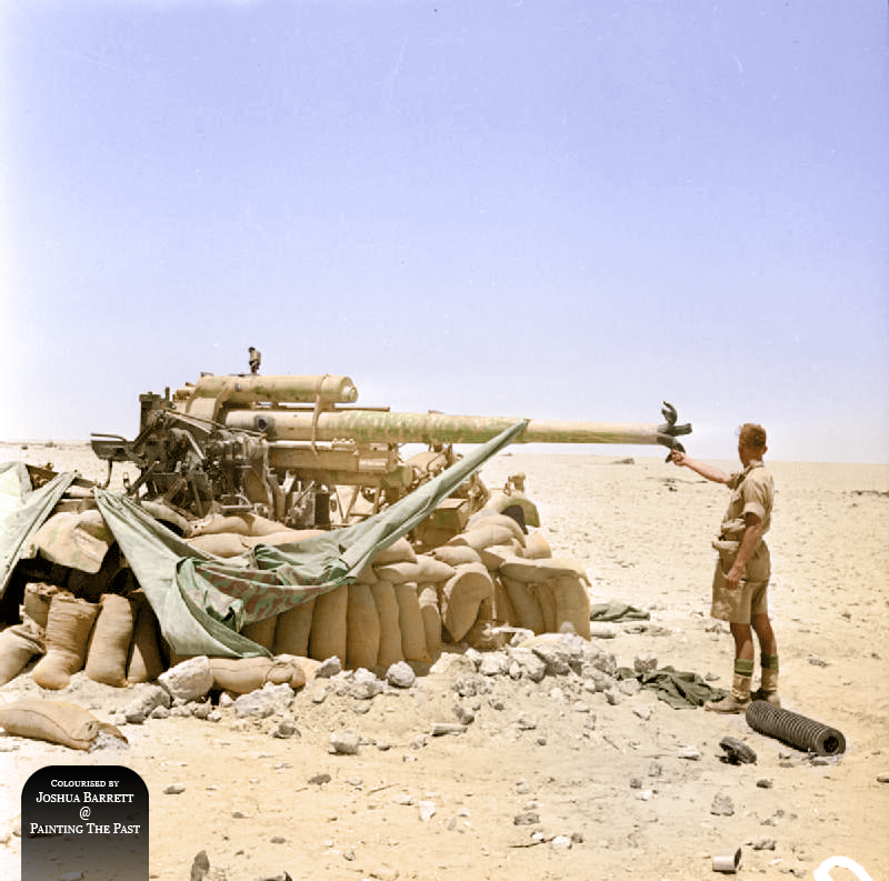 """A German 88mm anti-tank gun captured and destroyed by New Zealand troops near El Alamein, 17 July 1942.""  A Commonwealth soldier inspects the banana-peeled barrel of a knocked-out 88mm anti-tank gun. A penetration point can be seen in the side of the breech-end of the barrel, above the elevation mechanism.   The Commonwealth forces enjoyed relative success in North Africa with tanks like the Matilda II, an infantry tank, virtually impervious too all the anti tank guns fielded by the Axis at"