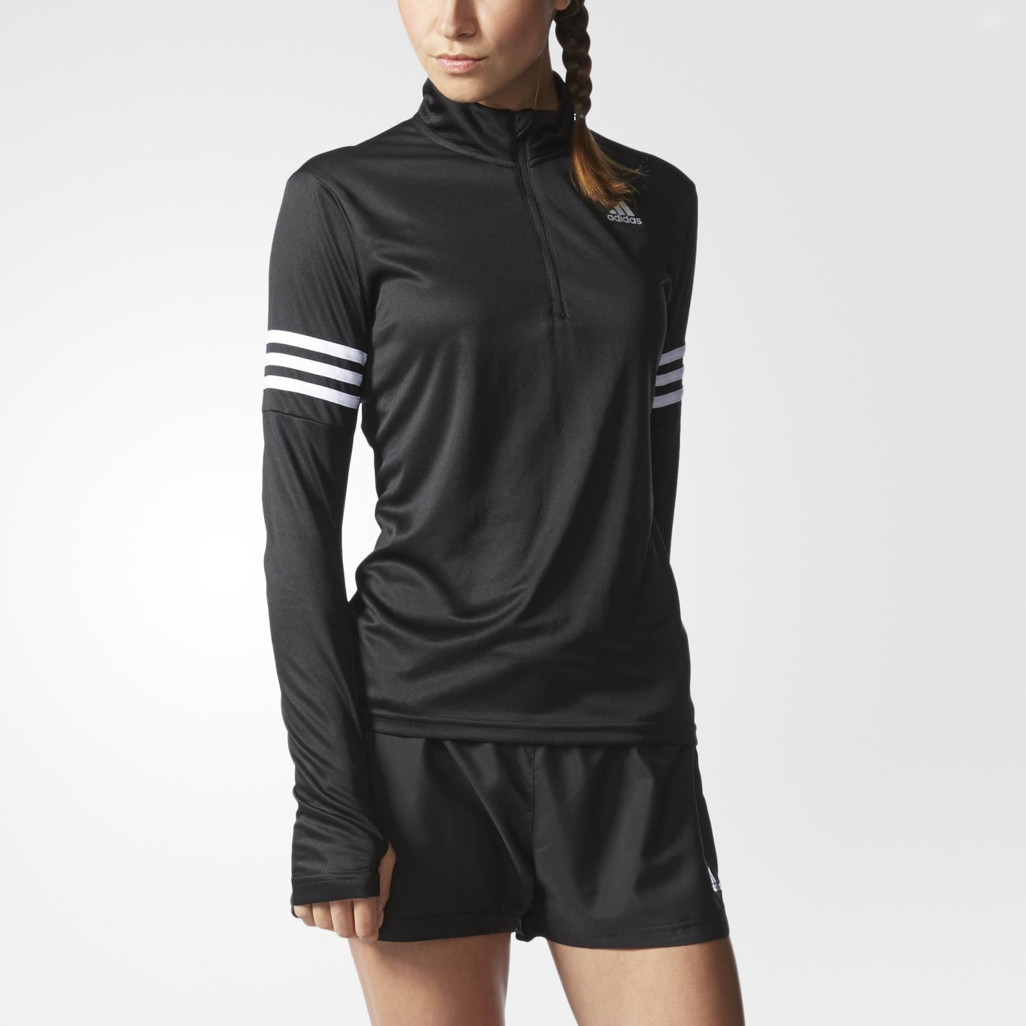 This women's half-zip running shirt helps sweep sweat out of your way. Made from moisture-wicking climalite® fabric with recycled content, it features thumb holes on the sleeves that keep them from riding up. This product is part of the Better Place Program: Products are built in a sustainable way to make the world a better place.