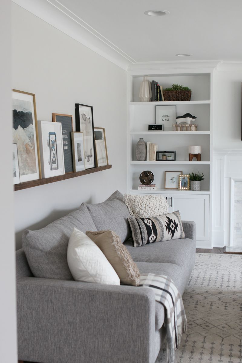 Photo of DIY Picture Ledge Over the Couch Filled with Art | The DIY Playbook
